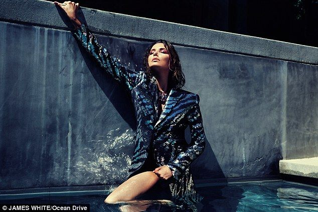 Bathing beauty: Eva took a dip in the pool in a sequined blazer ...
