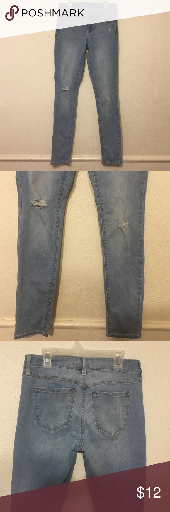 Faded Old Navy jeans with ripped holes at knees. Faded, ripped holes at knees, like new. Only used to fit but it didn't fit me well, it's stretchable, comfy, looks good with big hips and thighs. Old Navy Jeans Skinny
