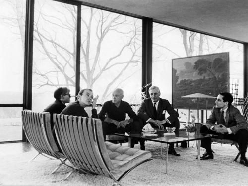 """From left: Andy Warhol, David Whitney, Philip Johnson, Dr. John Dalton, and Robert A. M. Stern in the Glass House in 1964. Photography by David McCabe """"Oh to be a fly on the wall in that conversation."""""""