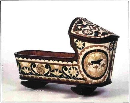The wooden construction of this hooded cradle was made about 1868 in Mahone Bay, Lunenburg County, Nova Scotia. It is covered with birch bark panels inserted with porcupine quills, a Native form of decoration. This example of quillwork features many traditional designs and intricate detail and is the only known surviving work by noted 19th century Mi'kmaq artist Christianne Morris.