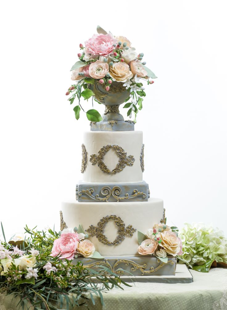 Here you go laura, This is the photo featured on cakegeek today! This Secret Garden inspired cake is truly a work of art! Everything (including the flowers on the cake) were made by hand and are edible. | cake designer: The Flour Garden | stylist/planner: Social Graces Events | garland: J. Kent Freeman Floral Design | photo: creationstudiosgallery.com #southernbridemagazine #cake #weddingcake #secretgarden #thesecretgarden #gardenwedding #gardenweddingcake