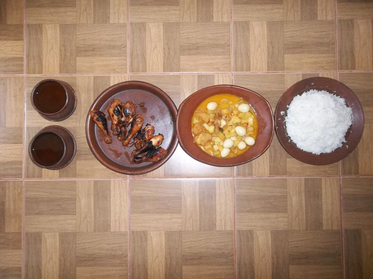 traditional drink and food from Indonesia. wedang sere, ayam bacem, sambel goreng, nasi (left to right)