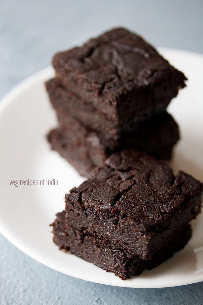 eggless brownie recipe with step by step pics. easy and yummy chocolate brownie made with cocoa powder. brownies are soft, moist & cake like.
