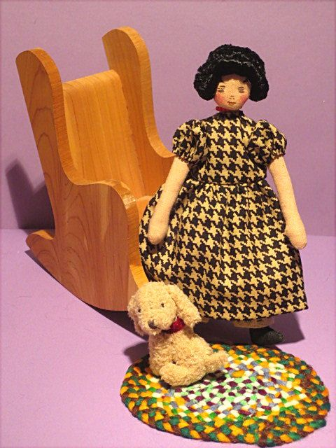 Cloth original doll by Barb Spencer.  Hitty is being sold with her wooden rocking chair, her oval braid rug and puppy.  Is signed and comes with certificate of authenticity.  $124.99 plus $10. for shipping and insurance.