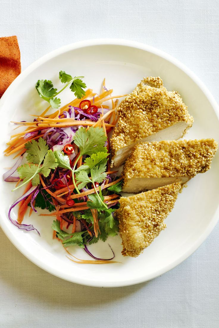 This sesame crusted chicken pairs perfectly with a red cabbage slaw flavored with ginger, chilis, and fresh lime juice.