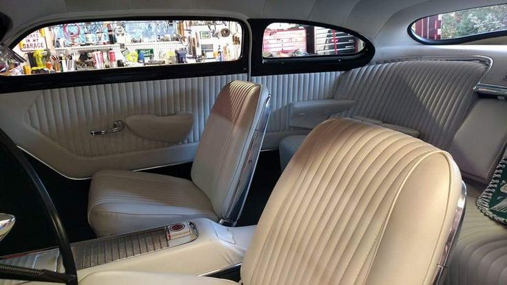 simply amazing custom merc interior in pleated tuck n roll white and low back bucket seats. Black Bedroom Furniture Sets. Home Design Ideas