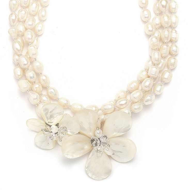 An exotic bridal necklace with genuine freshwater pearl flowers and Austrian crystals is perfect beach or destination wedding jewelry.