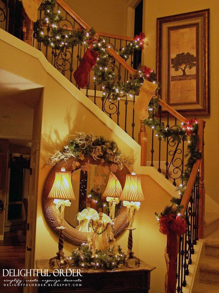Delightful Order: Staircase Christmas Decorating - I like the foyer table / mirror / lamp arrangement
