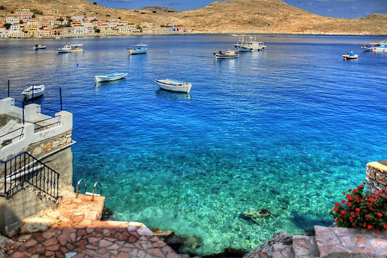 Crystal clear by Tom Gomez  The crystal clear waters in the bay of Nimborio on the Greek Island of Halki (Chalki).