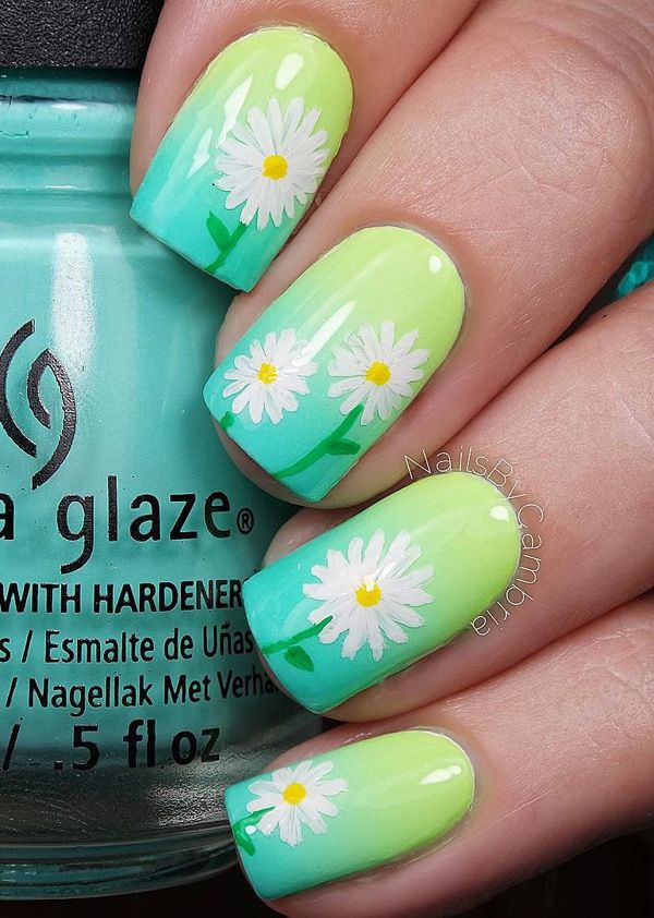 A very pretty spring nail art design. Starting with a green gradient base color, white flower details are then painted on top. This creates a warm and vibrant vibe for your nails. | Romeo and Juliet Couture