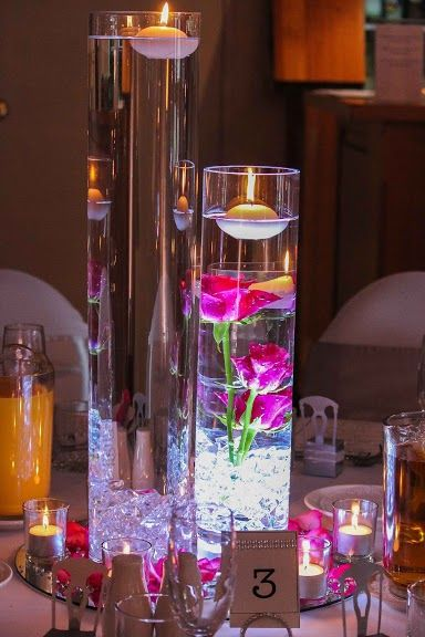 Beautiful Flowers and candles are floating. Wedding table centrepieces. wedding decorations unique