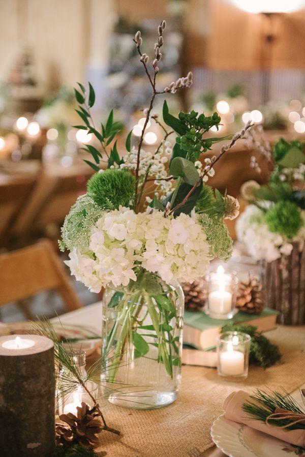 hydrangea and greenery centerpiece - photo by Allie Siarto Photography http://ruffledblog.com/woodland-michigan-barn-wedding