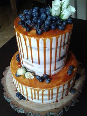 Naked cake with caramel drizzle Mascarpone cream cheese filling with blueberries