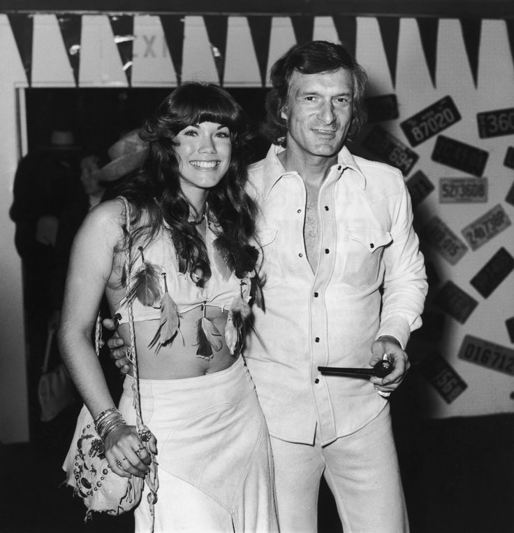 American publisher Hugh Hefner, of Playboy Enterprises, smiles with his girlfriend, American actor and model Barbi Benton as they attend the 21st annual SHARE fund raiser for The Exceptional Children's Foundation. She wears a feathered blouse and he holds a pipe.  (Photo by Frank Edwards/Getty Images) via @AOL_Lifestyle Read more: https://www.aol.com/article/finance/2017/09/28/new-owner-of-the-playboy-mansion-plans-expansion/23226523/?a_dgi=aolshare_pinterest#fullscreen