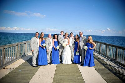 Pompano beach pier. Bill levkoff horizon blue bridesmaid dress and grey suits for the guys