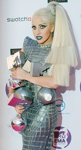 Lady Gaga poses in a silver Paco Rabanne dress after the 2011 MTV Europe Music Awards in Belfast.