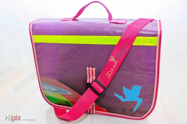 This is what a DeskBag looks like. The school bag, when folded open, provides instant desk support at school and at home. It is made from recycled vinyl billboard material and if looked after well, can last a school career. See more at www.prworx.co.za/DeskBags or www.facebook.com/DeskBags