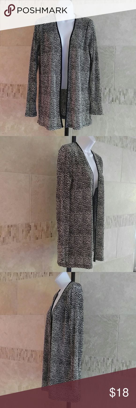 Gorgeous Virgo Animal Print Jacket! This classy black and white animal print jacket has tiny pleats and black trim.  Long sleeves.  The size tag is missing, but measures to be Medium.  Made of polyester and rayon.  Feels soft and silky.  A great addition to your closet! Virgo Tops