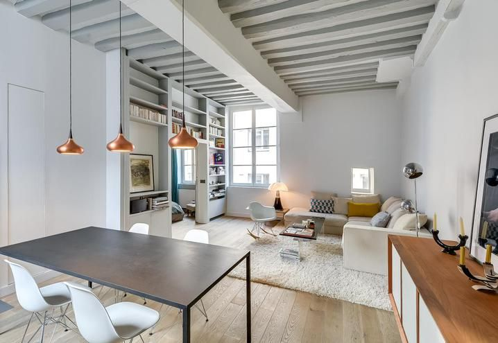 Small-sized flat enriched with custom-made furniture and legendary design must-haves
