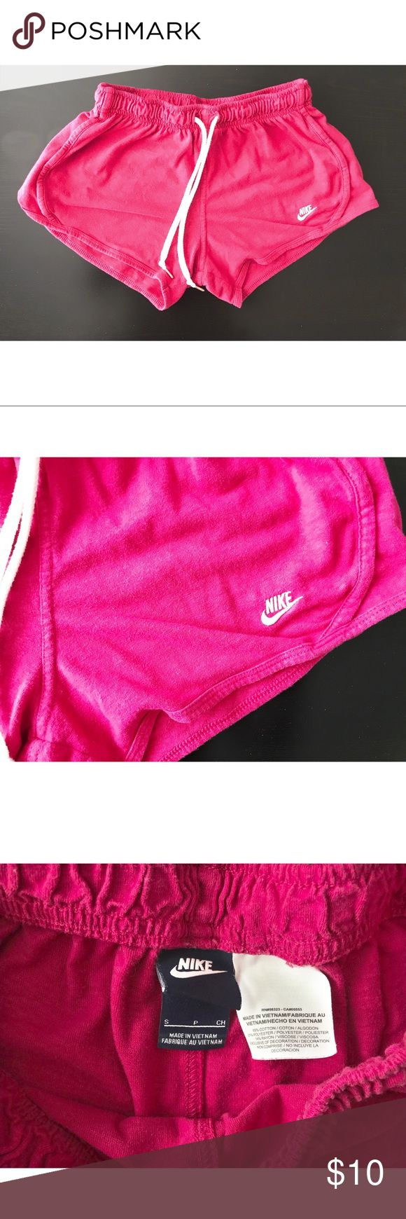 Pink nike cotton shorts These shorts have been worn but no longer fit me. They are a small however got more like an XS! These shorts were bought from the Nike store. Nike Shorts