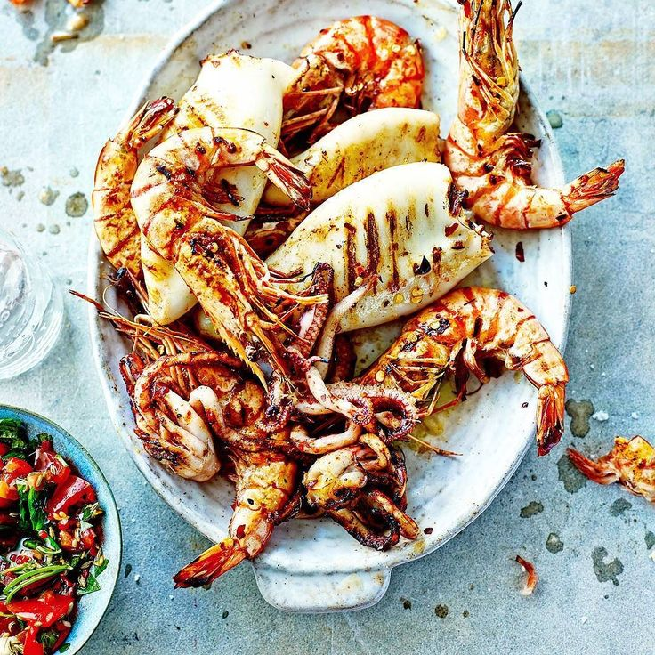 Woodfire-grilled Chilean prawn and calamari. Fresh. Exotic. Gorgeous. Brilliant. Cheers! -David  . Blog: http://ift.tt/1vCV6pv  #manvswild #seafood #pescatarian #paleo #crab #shrimp #prawn #fish #rice #muscles #octopus #oysters #calamari #weekend #lobster #instagood #foodstagram #foodgasm #foodporn #beer #bbq #barbecue #grill #grilling #asado #beautifulcuisines #chef #feedme #notallwhowanderarelost . . . @foodnetwork @todayfood @nytfood @huffposttaste @foodgawker @foodbeast @thefeedfeed…