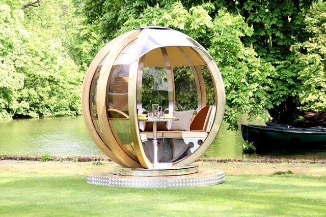 The G-Pod, created by British gardening specialists Ornate Garden, is a sphere. Crafted of aluminum, stainless steel, and treated wood, the structures are available in a variety of sizes and purposes. The spherical shape not only looks cool but can also be rotated to protect people inside from the sun.