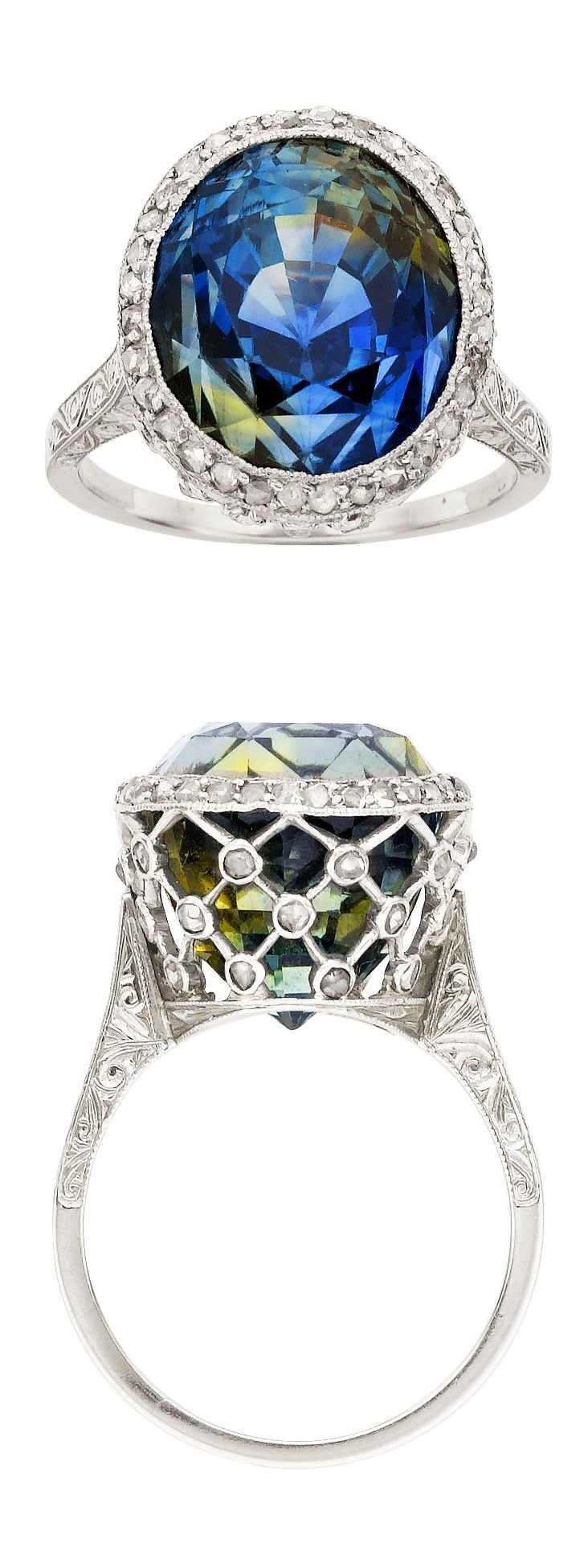 Edwardian Chameleon Sapphire, Diamond, Platinum, Gold Ring  The ring features an oval-shaped chameleon sapphire measuring 13.33 x 11.71 x 12.57 mm and weighing approximately 15.70 carats, accented by rose-cut diamonds weighing a total of approximately 0.60 carat, set in platinum, completed by an engraved 18k white gold shank