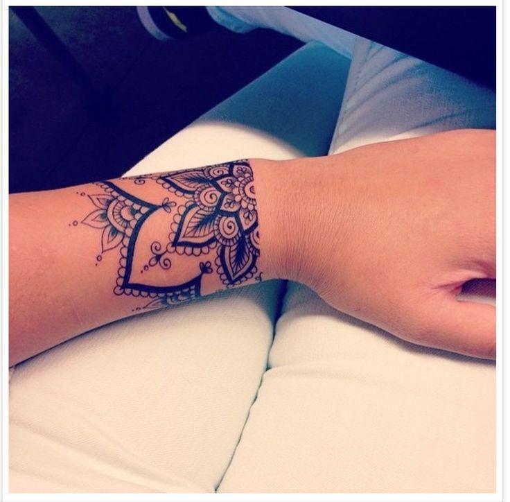 Watercolour mandala tattoo