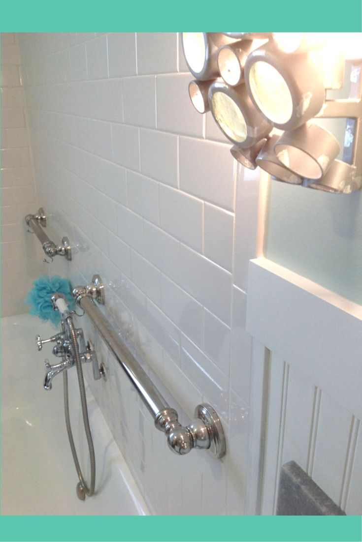 Decorative grab bars in a cottage style home decor. Safety can fit with style! Check out the decorative grab bars from Moen  Learn more here - http://blog.innovatebuildingsolutions.com/2015/01/10/personalizing-cottage-style-bathroom-south-euclid-ohio/ #InnovateBuilding