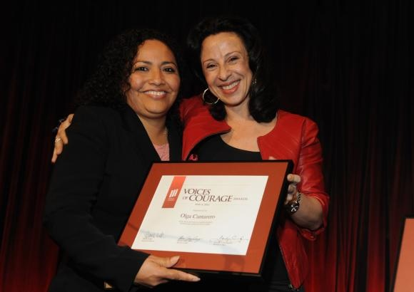 Maria Hinojosa (right) presents Voices of Courage Award to Olga Cantarero  Photo by: Don Pollard
