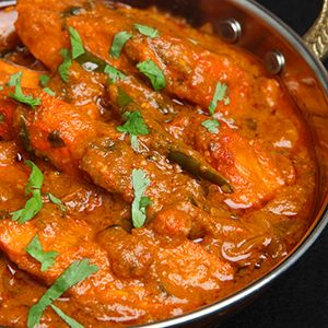 Chicken Tikka Masala is a very popular Indian dish that is best described as…