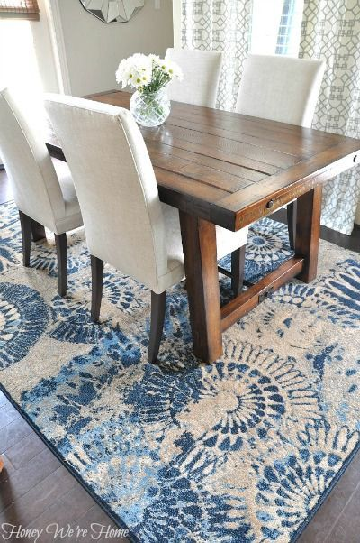 Table, chairs & beautiful rug