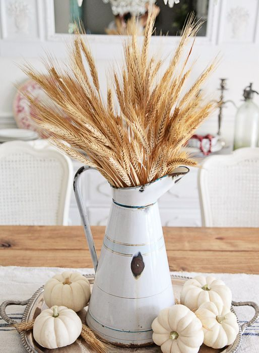 How to Style a French Farmhouse Fall Table from Shabbyfufu Blog. French enamelware pitcher with  white baby boo pumpkins look beautiful on this table.