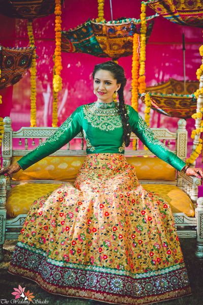 Mehendi Outfits- Yellow Floral Lehenga | WedMeGood | Full Sleeve Emerald Green Blouse with a Yellow FLoral Lehenga  #wedmegood #indianbride #indianwedding #mehendioutfit #floral #lehenga #mehandi #decor #umbrella #bridal