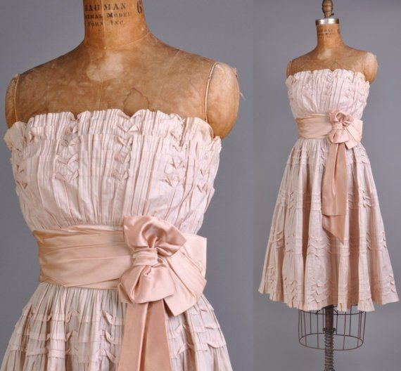 1950s Cocktail dress. This just might inspire me to host a 1950's cocktail party...