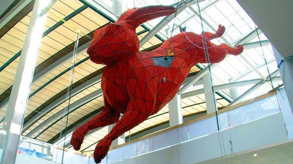 """Things have been particularly dismal for the Sacramento Airport since 2008, when its annual passenger count began to fall from nearly 11 million in 2008 to 9 million last year. Airport staff seem to think a floating, 56-foot-long aluminum sculpture of a polygonal bunny leaping into a giant suitcase by artistLawrence Argentis the just the right medicine for their traffic woes. """"The rabbit is suspended over the escalator, leaping toward a granite suitcase the size of a queen bed two floors…"""