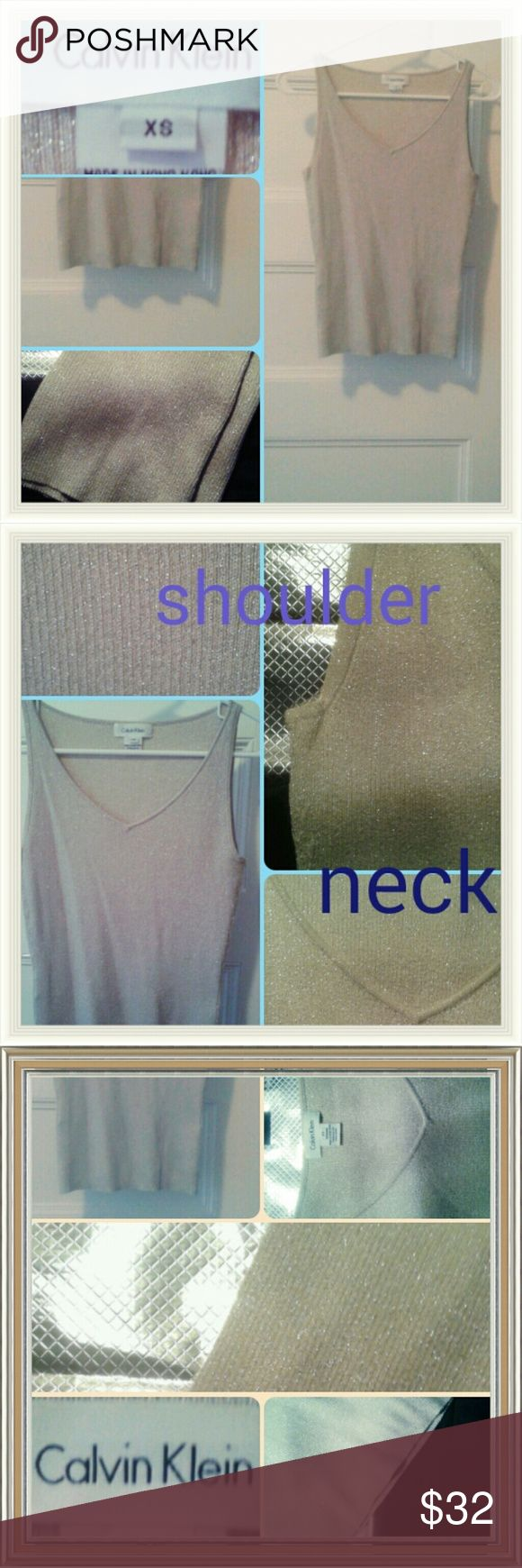 CALVIN KLEIN TOP Designer Calvin Klein this is a beautiful sleeveless tank top a light gray to silver color with metallic embossed on the whole top front and back you will Shimmer beautiful as you wear it out in the evening in the daytime you will Sparkle size extra small but if you are small you can fit it it's meant to be a fitted top brand new Final sale Calvin Klein Collection Tops Tank Tops