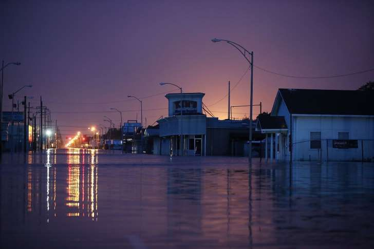 PORT ARTHUR, TX - AUGUST 31: A flooded street is seen after the area was inundated with flooding from Hurricane Harvey on August 31, 2017 in Port Arthur, Texas. At least 37 deaths related to the storm have been reported since Harvey made it's first landfall north of Corpus Christi August 25. (Photo by Joe Raedle/Getty Images)