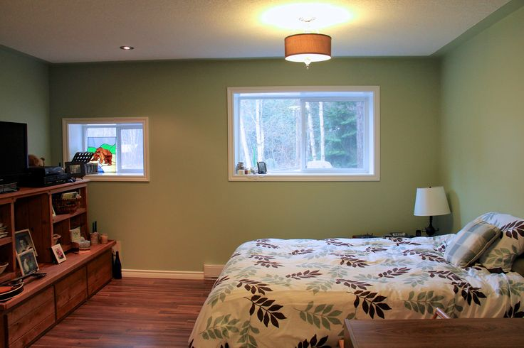 One of the two downstairs bedrooms, both of which have walk-in closets, as does the upstairs master.