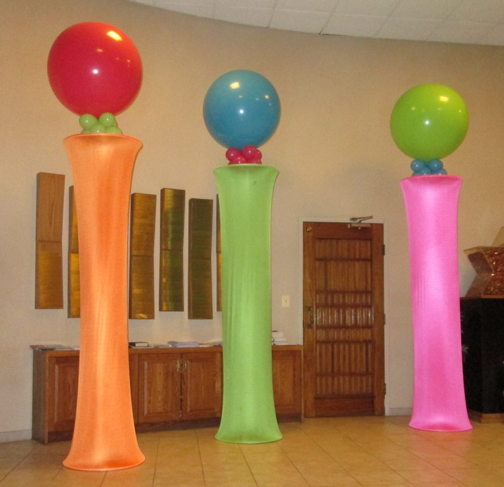Fabric columns with 3 foot toppers.  Bright colors!  Big pop!  Nice effect!  This can be used as a backdrop or entry way or behind registration tables.