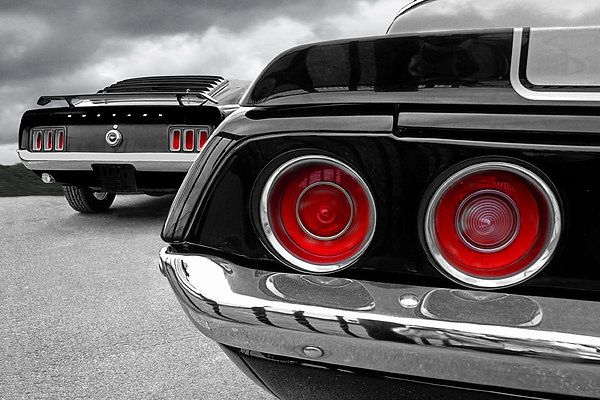 A Classic Ford Mustang Fastback In Black And White With The