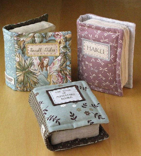 """Little Books by PatchworkPottery, via Flickr; 4"""" x 5"""" stuffed books to use as decorations on a shelf or as pincushions"""