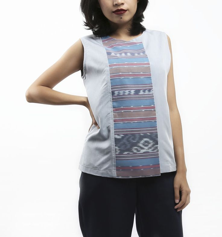 Tula Top by MaenKaen. An adorable top in blue color and with a little touch of tenun fabric at the center of the clothes. It features sleeveless top with hidden button and also available in free size/ all size. http://www.zocko.com/z/JKIdy