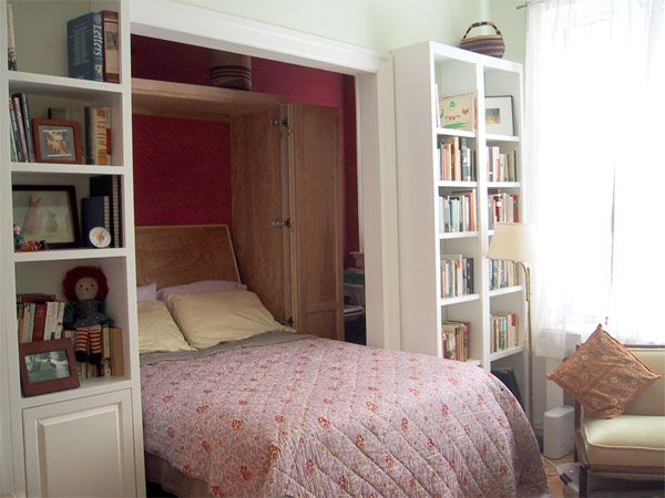 This Murphy bed takes up part of a tiny office (4' x 8') and folds out into the living room at night.