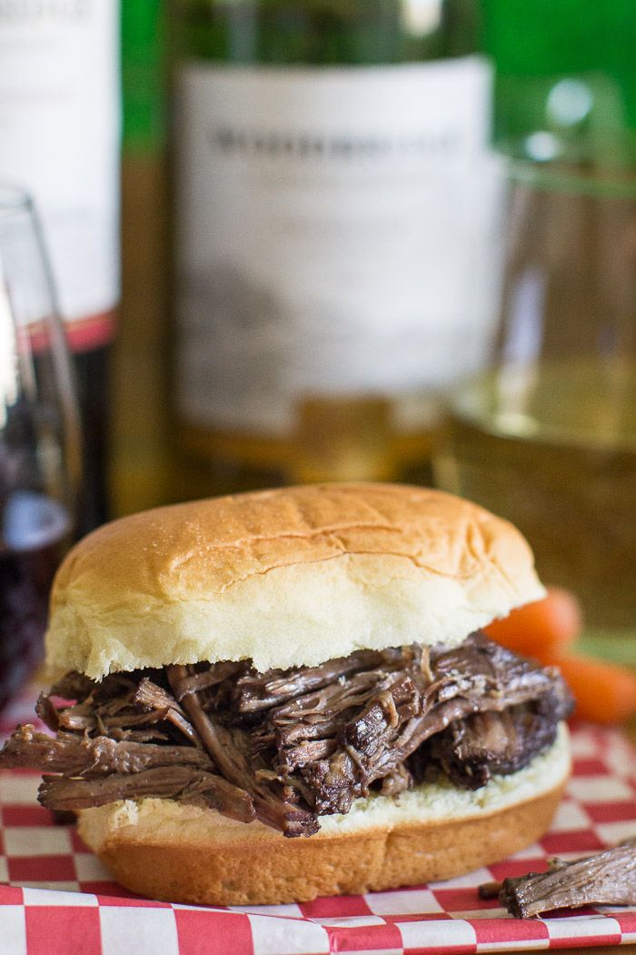 Classic French fare is transformed into sublime shredded beef sandwiches! My Easy Beef Bourguignon recipe roasts low and slow in a red wine sauce, perfect for Game Day entertaining.