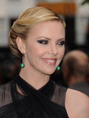 5 Minute Hairstyle | Charlize Therons Vintage Rolls Updo - Get Charlize Therons fabulous looking vintage rolls updo in 5 minutes or less by checking out the following step-by-step tutorial as gorgeous hair doesnt have to come with sweat!