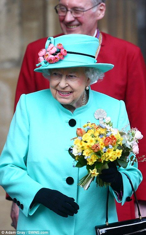 Burst of colour: The flowers contrasted beautifully with the Queen's turquoise coat as she left the church today