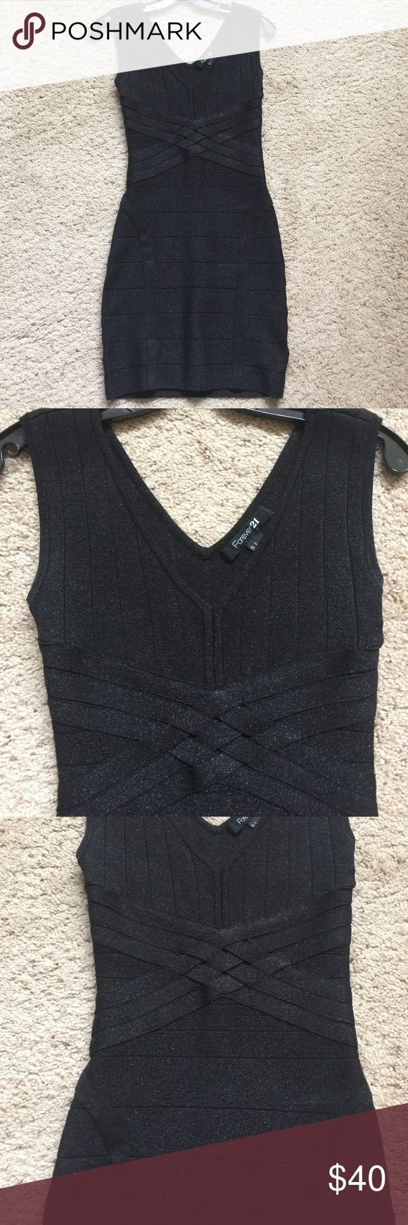 SUPER sexy little black dress NWOT Sz S Very sexy NWOT Lil black dress Sz S - side zip- details on front and back very figure flattering- slight metallic finish Forever 21 Dresses Mini