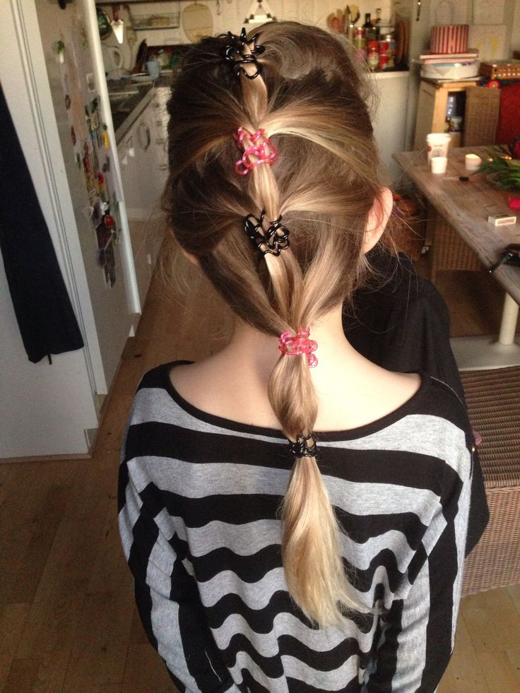 My youngest daughter with new spiral elastics in her hair. Super easy French braid cheat.