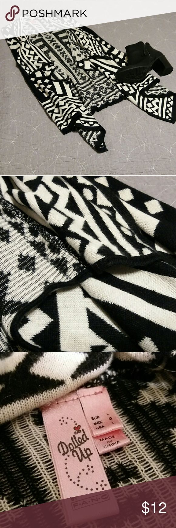 Vest Black and white vest with an Aztec pattern.  Made out of sweater material.  Excellent used condition.  - Please note that this listing is for the vest ONLY. Shoes not included. Dolled Up Jackets & Coats Vests